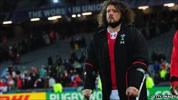Adam Jones on crutches