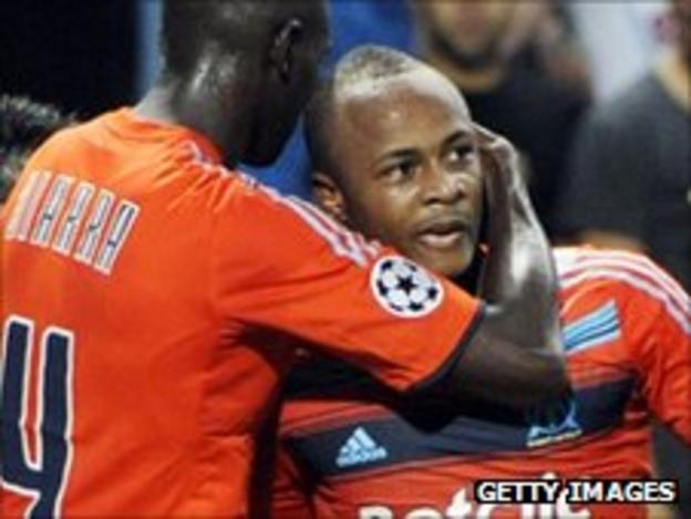 Andre Ayew (right) is congratulated after scoring against Dortmund