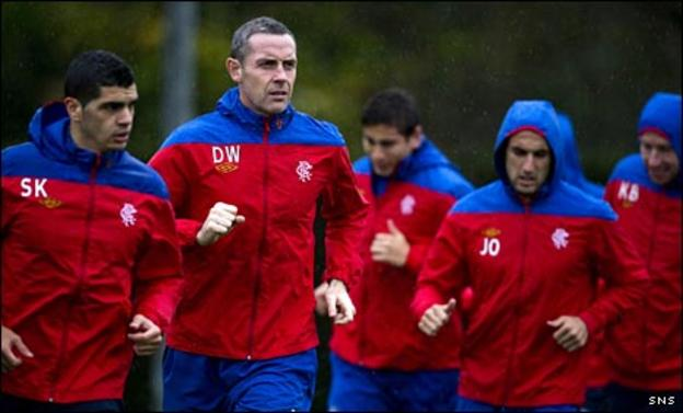David Weir (second left) in training