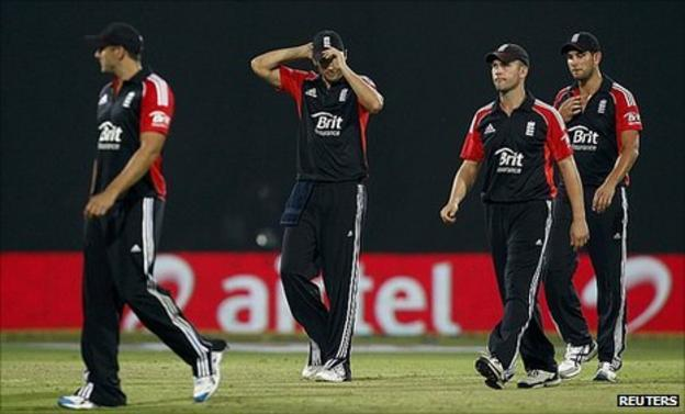 Alastair Cook (centre) trudges off with his team-mates in Delhi