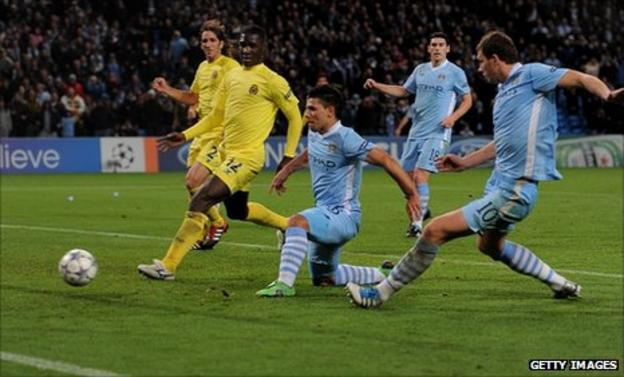 Sergio Aguero of Manchester City scores his team's second goal