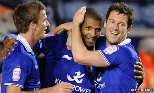 Jermaine Beckford is congratulated by Andy King (left) and David Nugent (right) after his goal