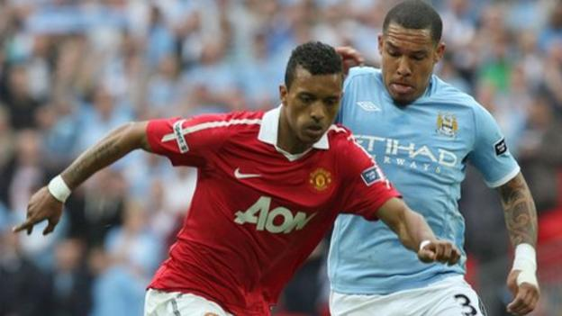 Manchester United's Nani and Manchester City's Nigel De Jong