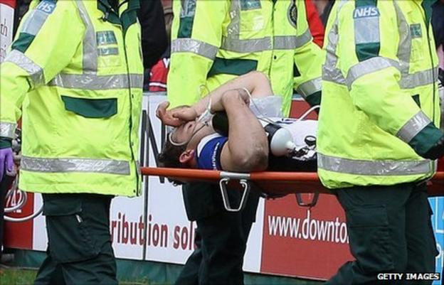 Olly Barkley gets carried off with a broken leg against Gloucester
