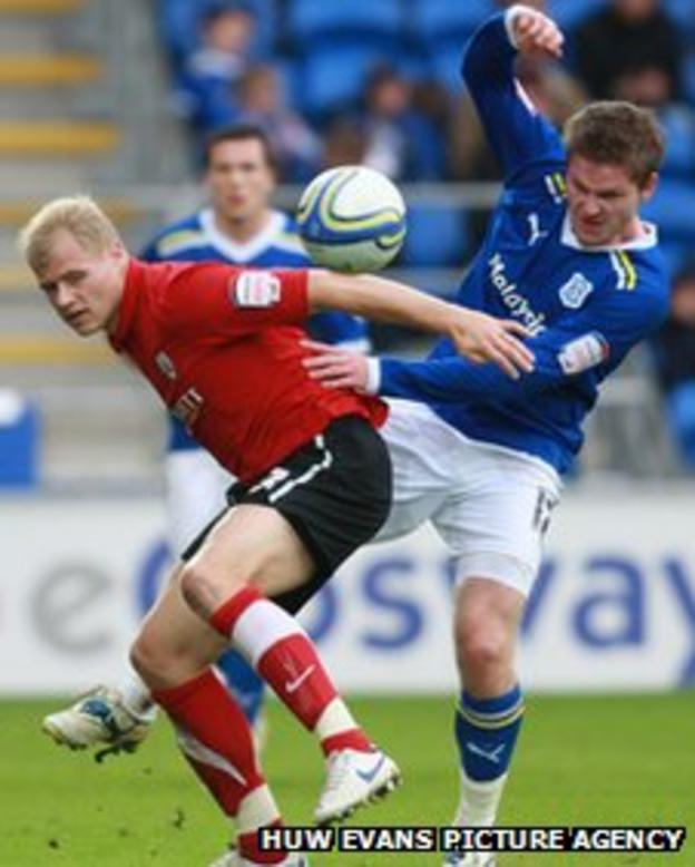 Gunnarsson battles for the ball with Barnsley's Jay McEveley