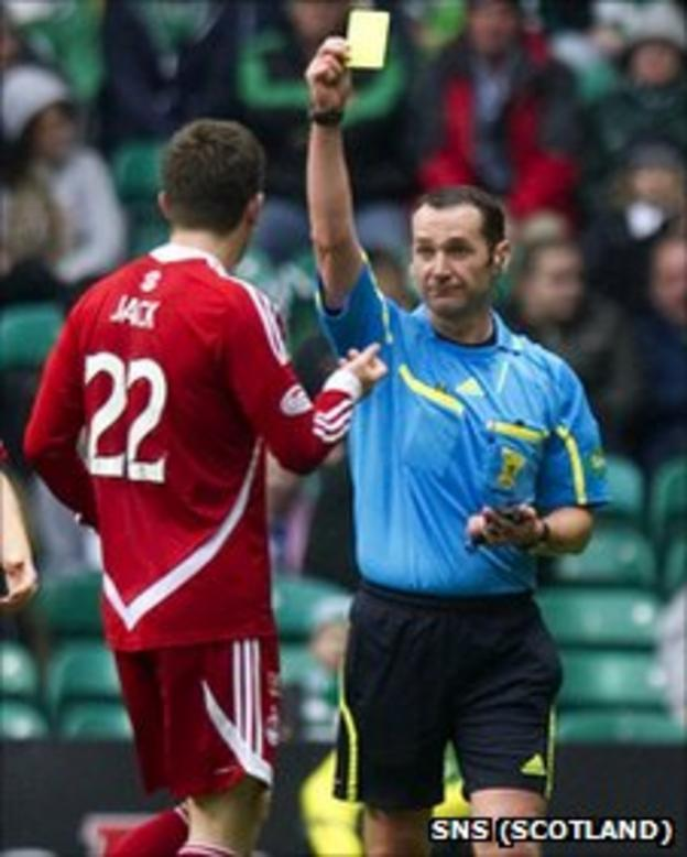 Aberdeen defender Ryan Jack is booked by referee Stevie O'Reilly