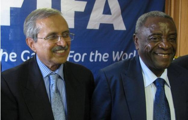 Committee chair Justice Ahmed Ebrahim and Zifa President Cuthbert Dube.