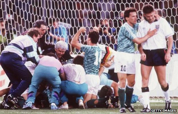 Chris Waddle is consoled after missing a penalty at the 1990 World Cup