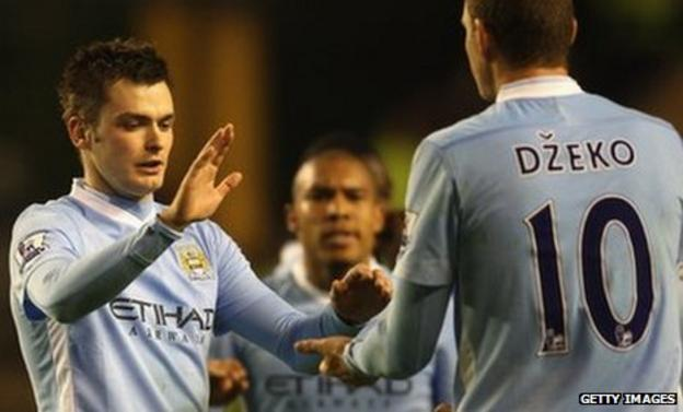 Adam Johnson (left) of Manchester City celebrates scoring his sides first goal with Edin Dzeko