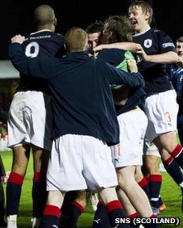 Falkirk celebrate their League Cup victory at Tannadice