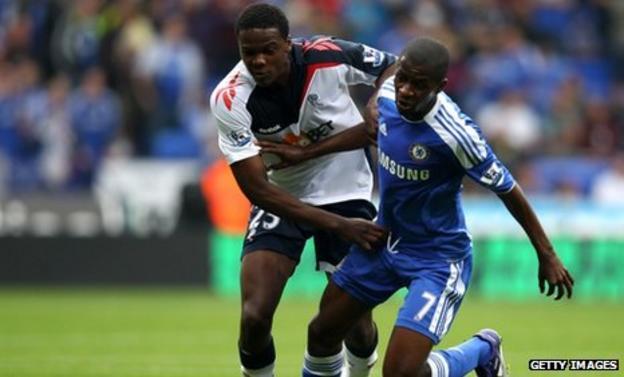 Bolton's Dedryck Boyata (left) challenges Chelsea's Ramires