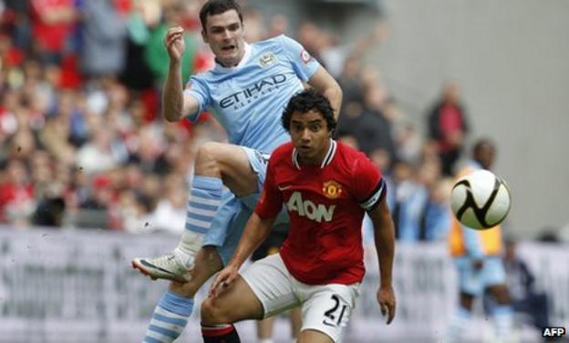 Manchester United defender Rafael and Manchester City winger Adam Johnson