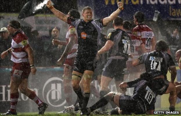 James Hudson (arms aloft) celebrates Newcastle Falcons' win against Gloucester last season