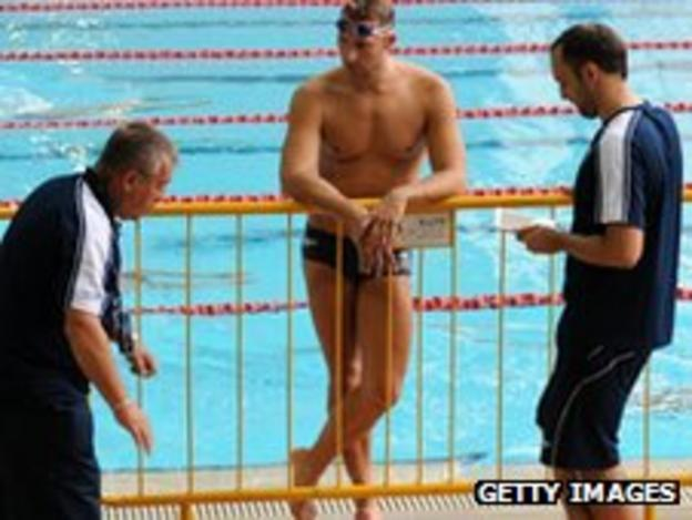 Ian Thorpe listens to Australian team officials during training ahead of the Singapore World Cup