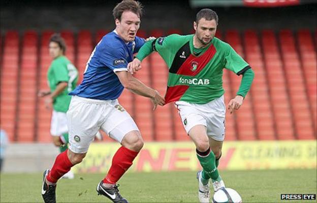 Linfield's Albert Watson challenges Gary Hamilton of Glentoran in a recent league game