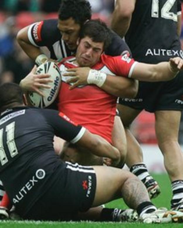 Wales' Danny Jones is stopped in his tracks by the New Zealand defence