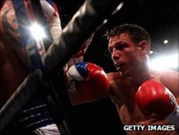 Michael Katsidis hammers into Ricky Burns on the ropes