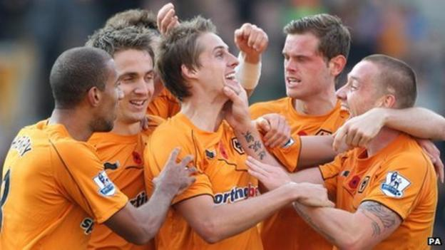 Wolves players congratulate David Edwards (centre) on his goal