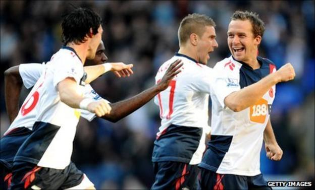 Kevin Davies (right) leads the celebrations after grabbing Bolton's opening goal