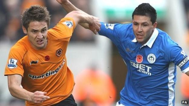 Antolin Alcaraz (right) challenges with Kevin Doyle (left)