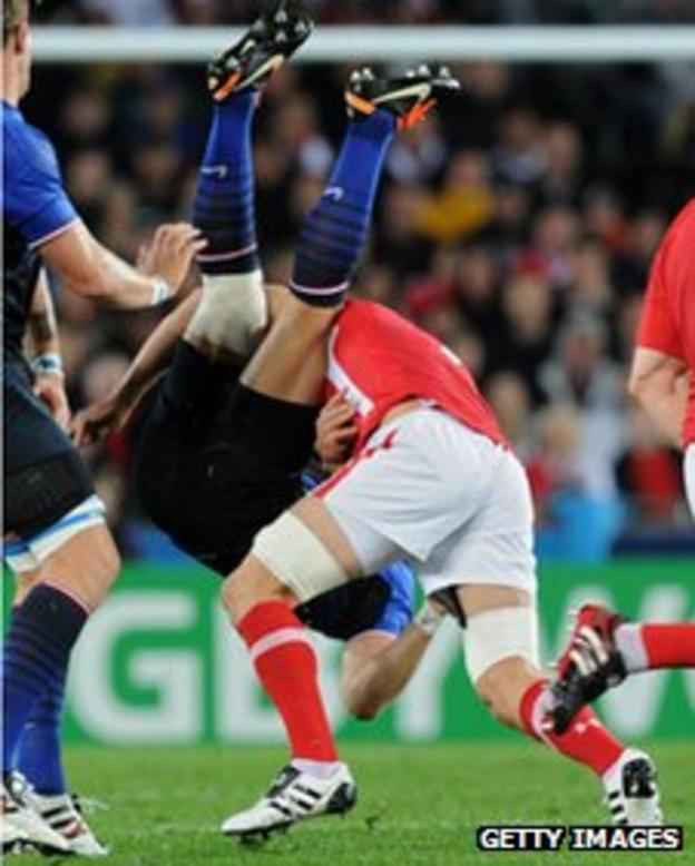 Wales captain Sam Warburton upends France wing Vincent Clerc in the World Cup