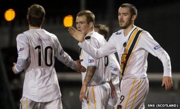 Darren Gribben celebrates with his team-mates after scoring for Berwick Rangers