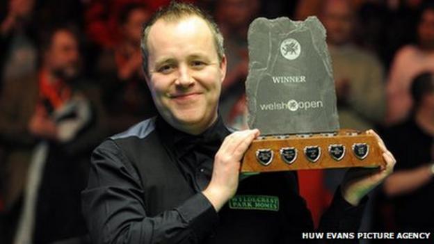 John Higgins celebrates after winning the final of the 2011 Welsh Open