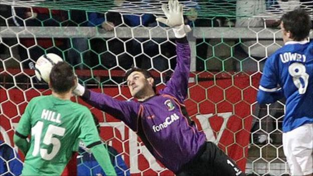 Elliott Morris keeps out a Linfield shot in the midweek win at the Oval