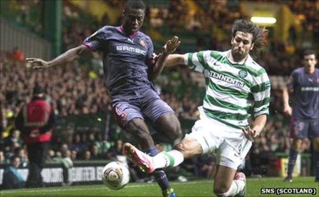 Celtic's Georgios Samaras slides in on Alexander Tettey of Rennes