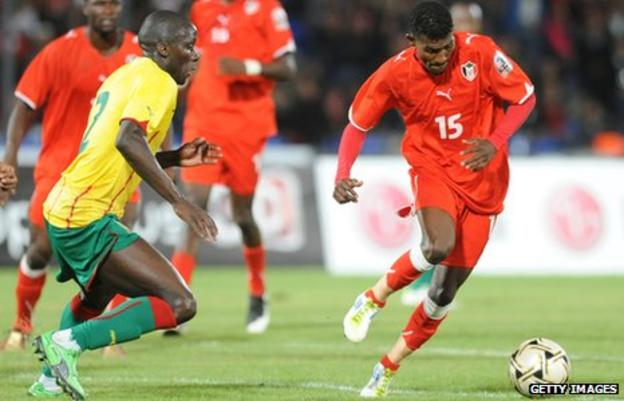 Benoit Angbwa of Cameroon (left) was one of the scorers in the win for the Indomitable Lions