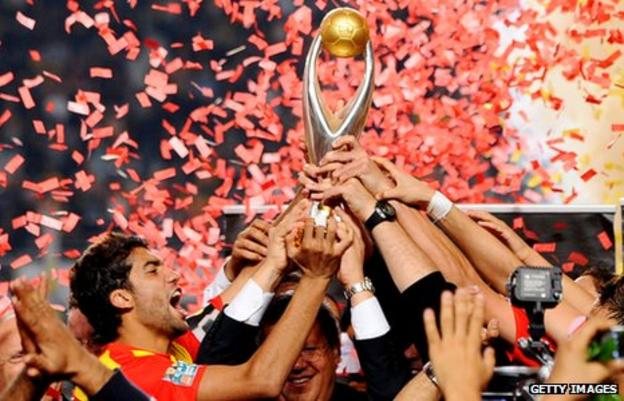 Esperance captain Oussama Darragi holds the African Champions League Trophy aloft