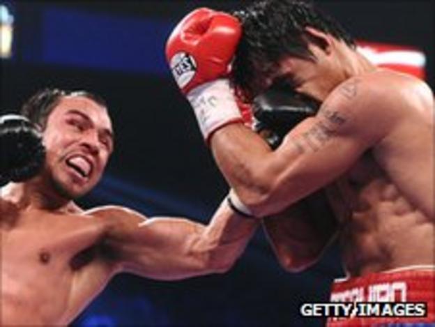 Juan Manuel Marquez lands a left on Manny Pacquiao