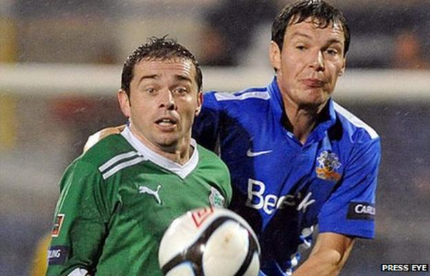 Chris Scannell of Cliftonville in action against Glenavon's Kyle Neill