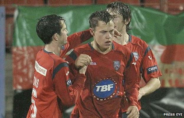 Johnny Black is congratulated after scoring Coleraine's equaliser
