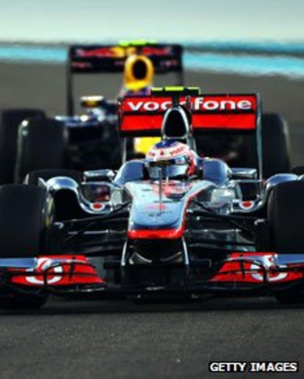 Jenson Button of Great Britain and McLaren leads from Mark Webber of Australia and Red Bull Racing during the Abu Dhabi Formula 1 Grand Prix