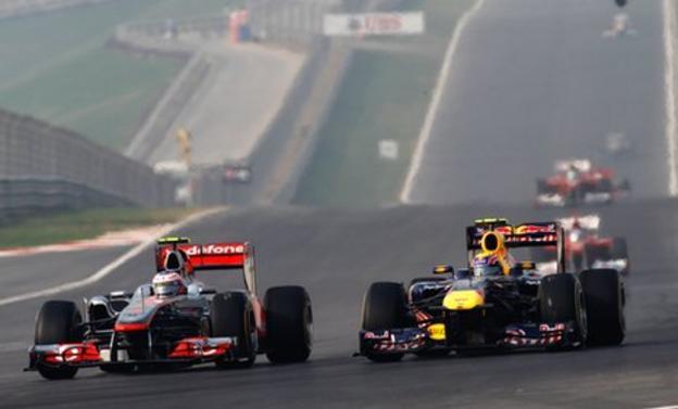 McLaren's Jenson Button tackles Red Bull's Mark Webber in Abu Dhabi