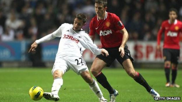 Angel Rangel under pressure from Michael Carrick during Swansea's 1-0 defeat to Manchester United