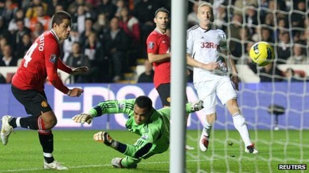 Garry Monk looks on as Javier Hernandez scores the winning goal for Manchester United