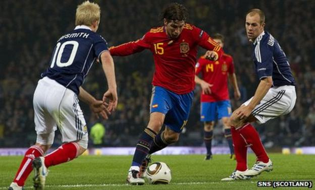 Spain defender Sergio Ramos causes problems for Steven Naismith (left) and Steven Whittaker (right)