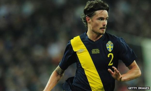 Mikael Lustig in action for Sweden