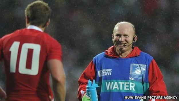 Neil Jenkins offers water and advice to Wales fly-half Rhys Priestland