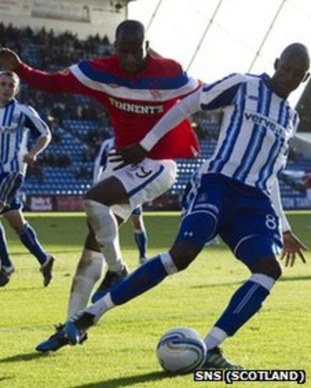 Rangers' Sone Aluko and Mohamed Sissoko of Kilmarnock