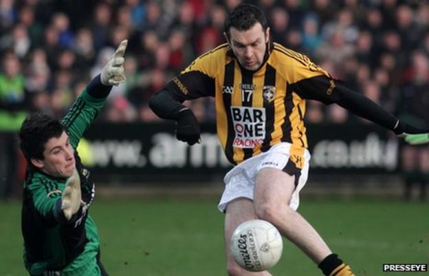 Oisin McConville is about to score past Burren keeper Cathal Murdock