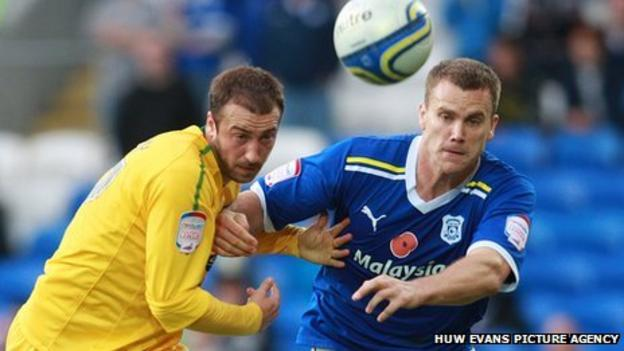 Cardiff defender Ben Turner and Crystal Palace's Glenn Murray compete for the cball