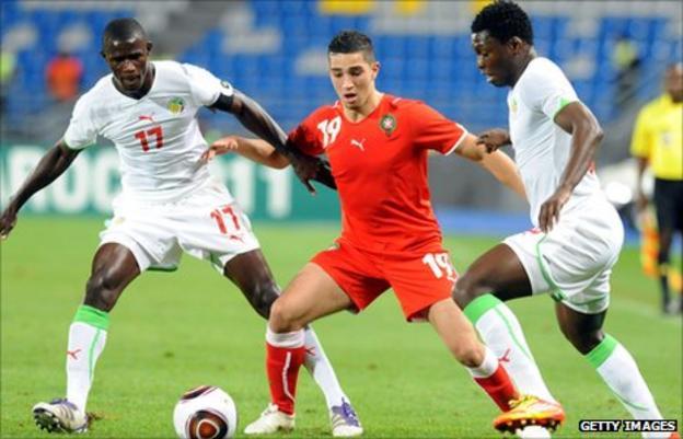 Senegalese Khassim Soumar (right) and Younes Itri (L) challenge Moroccan Lotfi Obilla (centre)