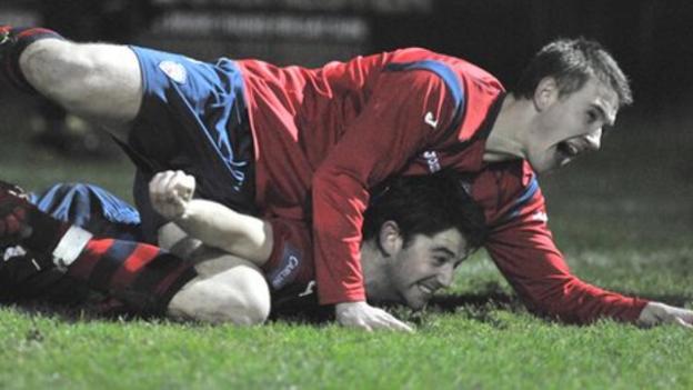 Shane Jennings jumps on top of goalscorer Curtis Allen at Suffolk Park