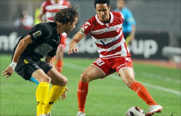 Smir Zekroumi of Moghreb Fes faces Youssef Mouihbi of Club Africain