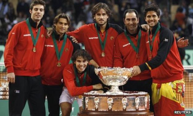 Spain's winning team with Rafael Nadal crouching at the front