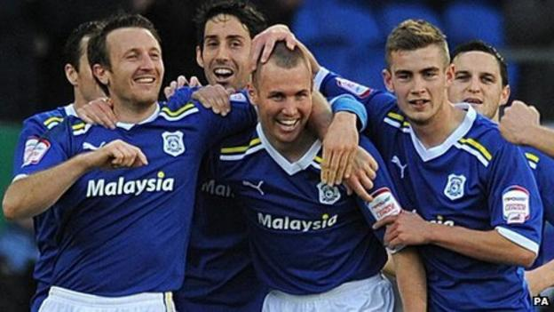Kenny Miller (centre) is mobbed by his Cardiff team-mates after scoring against Birmingham
