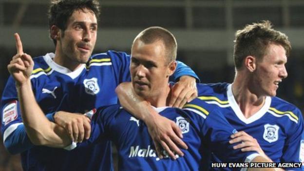 Kenny Miller (centre) celebrates with Peter Whittingham and Joe Mason